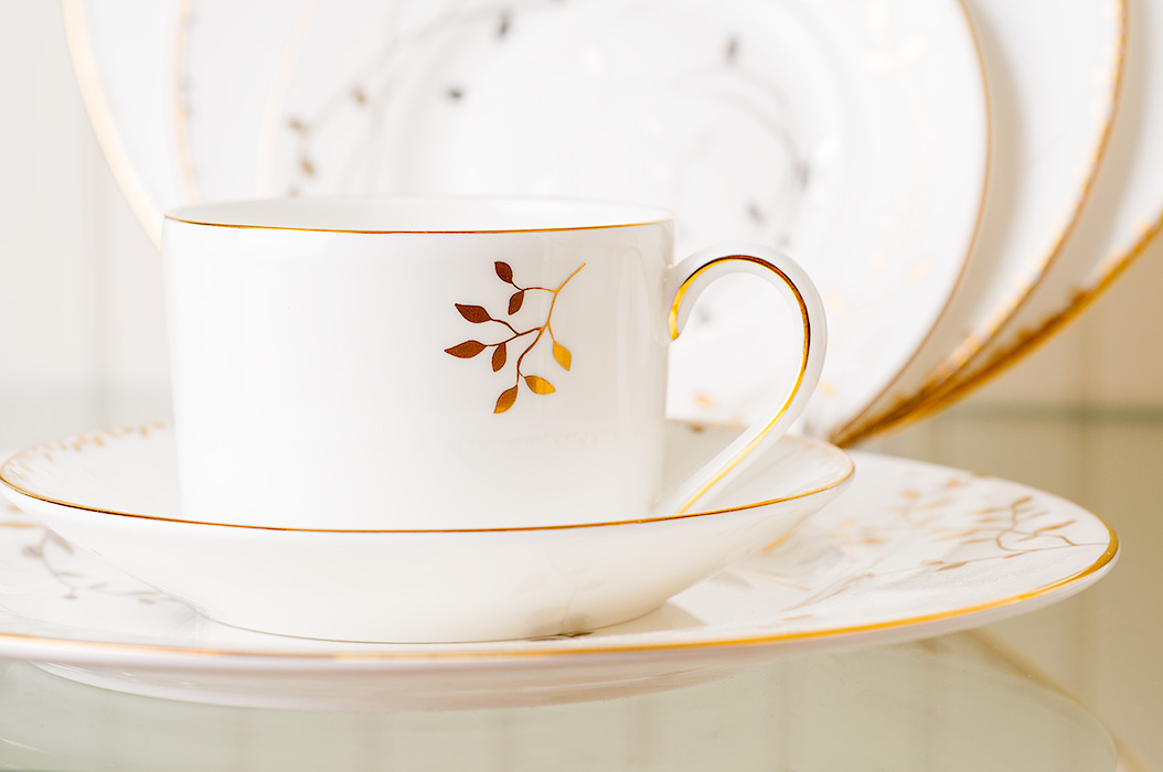 Product photography of elegant dishes in a retail setting.