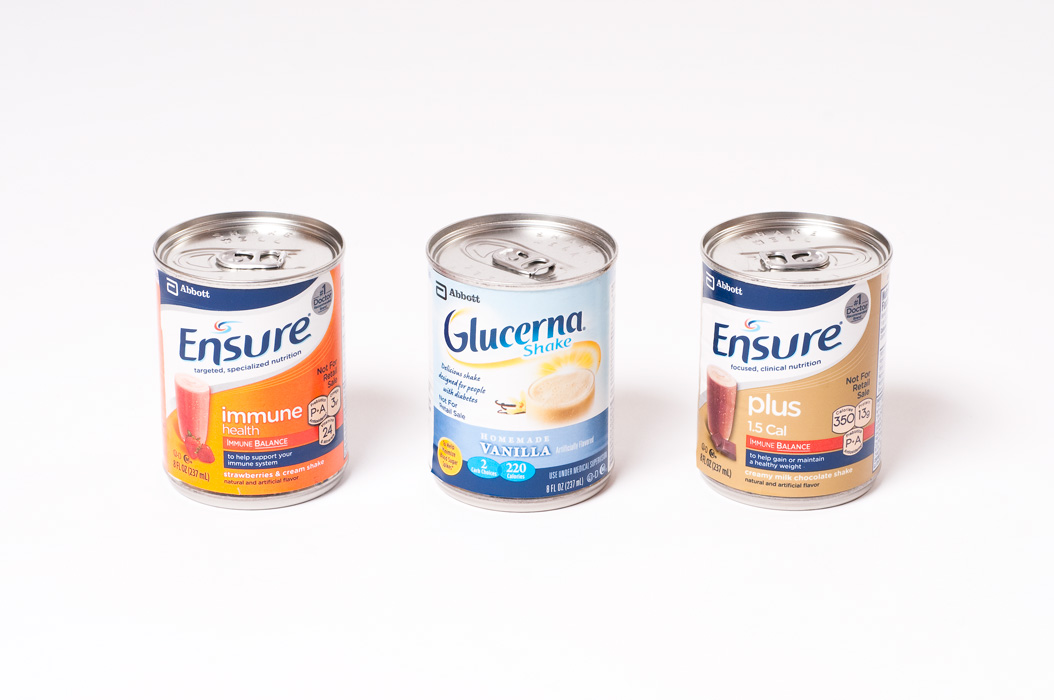 Canned food product photography of three cans on a spotless white background.